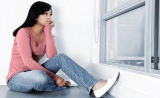 sad-woman-window-11091602