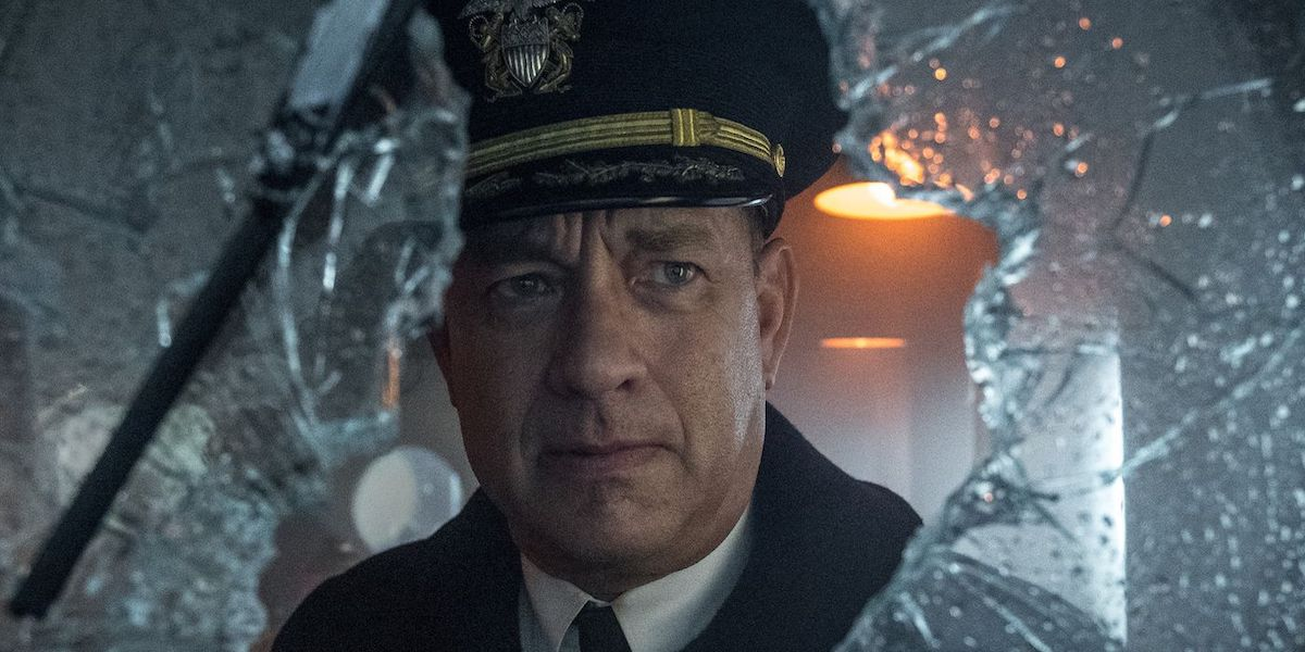 Commander Ernest Krause (Tom Hanks) looks through shattered glass in 'Greyhound'