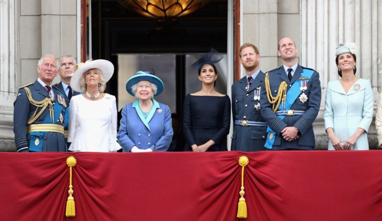 Prince Charles, Prince of Wales, Prince Andrew, Duke of York, Camilla, Duchess of Cornwall, Queen Elizabeth II, Meghan, Duchess of Sussex, Prince Harry, Duke of Sussex, Prince William, Duke of Cambridge and Catherine, Duchess of Cambridge watch the RAF flypast on the balcony of Buckingham Palace, as members of the Royal Family attend events to mark the centenary of the RAF on July 10, 2018 in London, England.