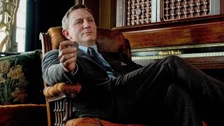 Daniel Craig sitting in chair as Benoit Blanc in Knives Out
