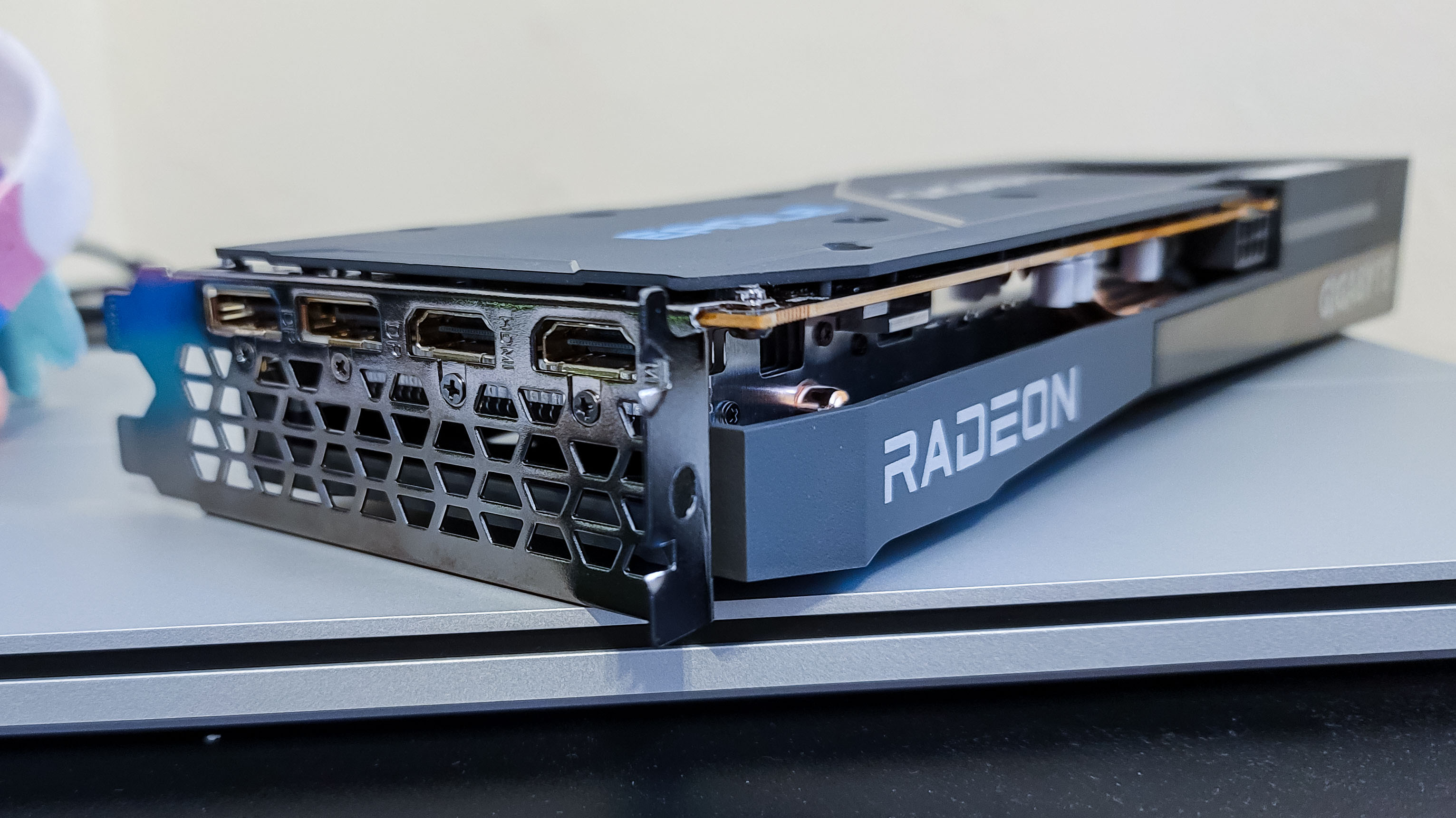 AMD Radeon RX 6600 on top of a laptop, on its side showing its ports