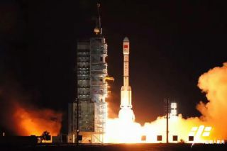 China's Tiangong-2 space laboratory for astronauts launches into space atop a Long March 2F rocket in this view from Jiuquan Satellite Launch Center in northwest China on Sept. 15, 2016.