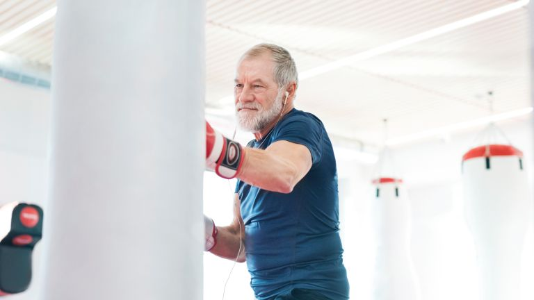 Man with a strong core doing boxing