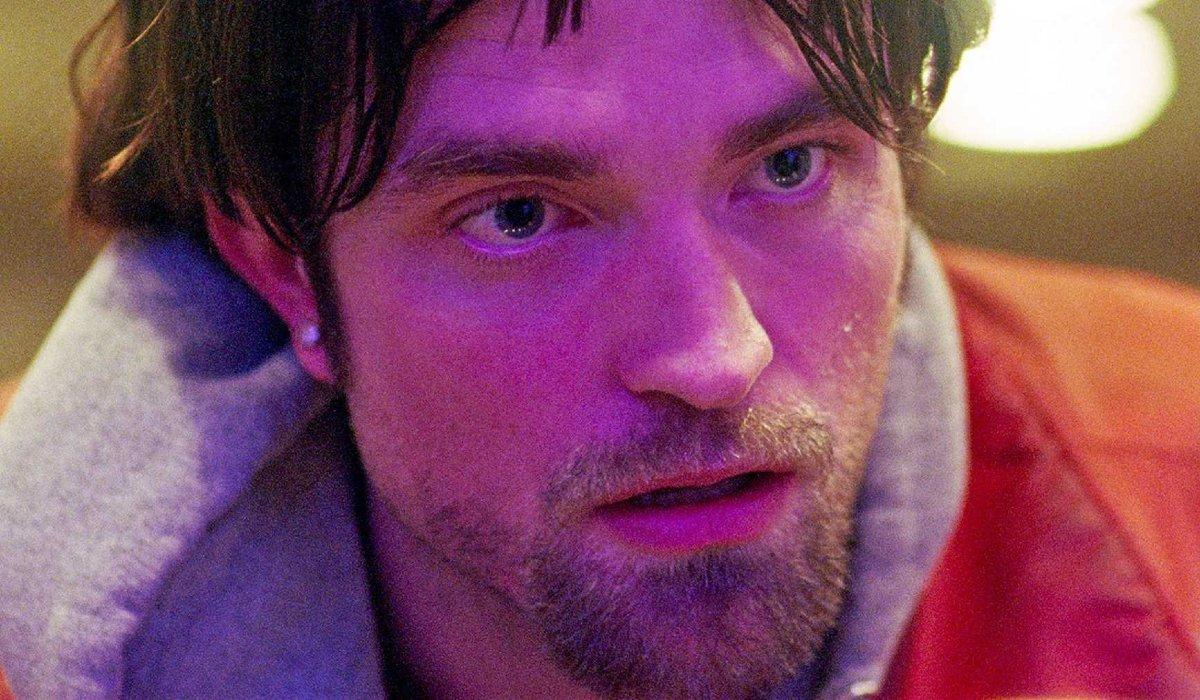 Good Time Robert Pattinson looks panicked in purple lighting