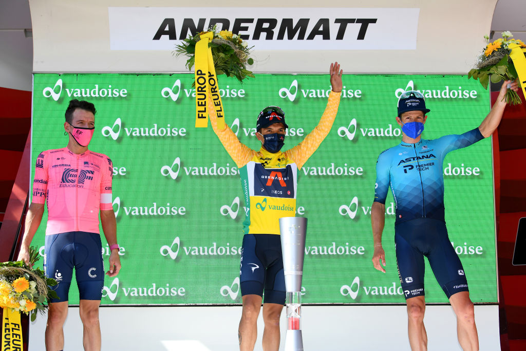 ANDERMATT SWITZERLAND JUNE 13 Rigoberto Uran Uran of Colombia and Team EF Education Nippo 2nd place Richard Carapaz of Ecuador and Team INEOS Grenadiers yellow leader jersey Jakob Fuglsang of Denmark and Team Astana Premier Tech 3rd place celebrates at podium during the 84th Tour de Suisse 2021 Stage 8 a 1595km stage from Andermatt to Andermatt Trophy UCIworldtour tds tourdesuisse on June 13 2021 in Andermatt Switzerland Photo by Tim de WaeleGetty Images