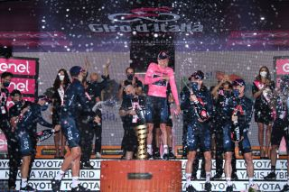 MILANO ITALY OCTOBER 25 Podium Tao Geoghegan Hart of The United Kingdom Jonathan Castroviejo of Spain Rohan Dennis of Australia Filippo Ganna of Italy Jhonnatan Prado Narvaez of Ecuador Salvatore Puccio of Italy Ben Swift of The United Kingdom Team INEOS Grenadiers Trofeo Senza Fine Trophy Celebration Champagne during the 103rd Giro dItalia 2020 Stage 21 a 157km Individual time trial from Cernusco sul Naviglio to Milano ITT girodiitalia Giro on October 25 2020 in Milano Italy Photo by Tim de WaeleGetty Images