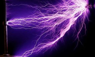 An image shows arcs of electricity generated with a Tesla coil, an earlier experiment in shooting energy across open space that unfortunately would not effectively charge your phone.