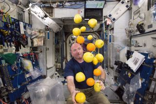 Scott Kelly with Fruit on the International Space Station