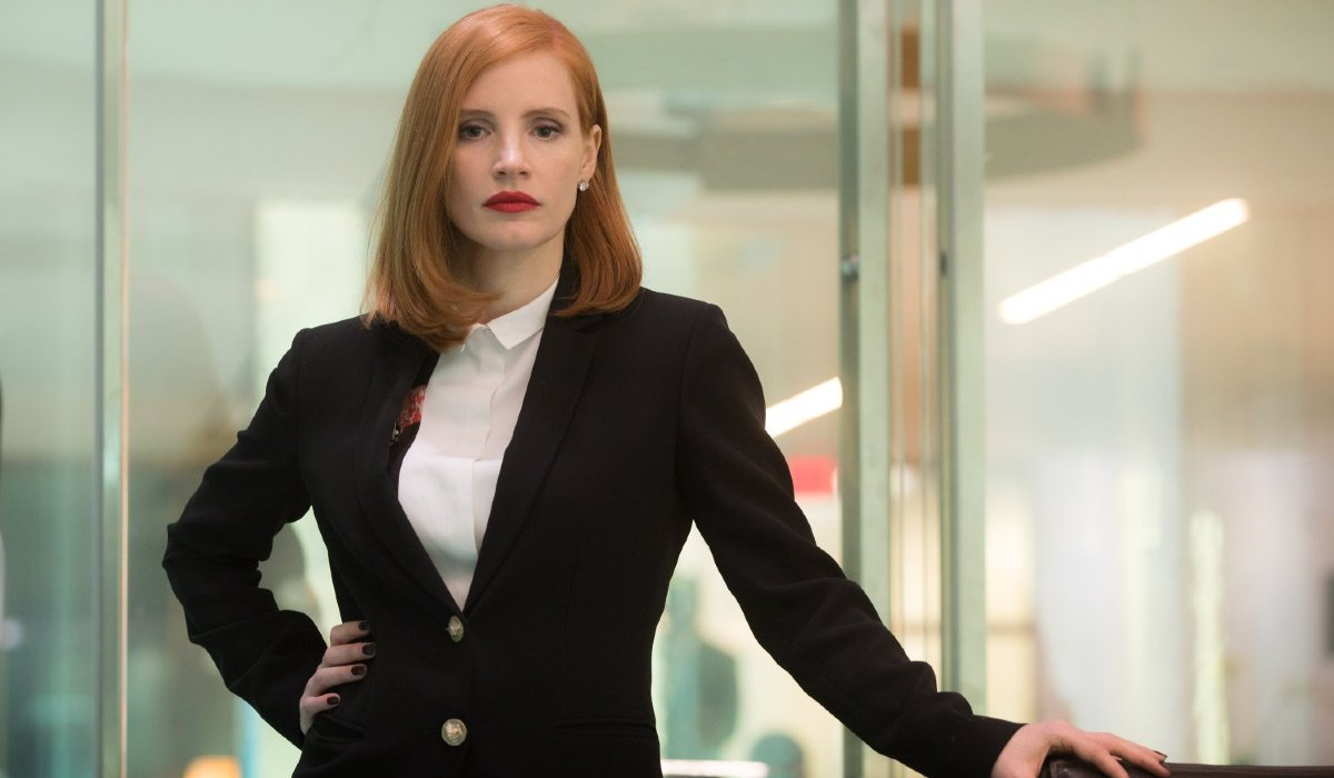 Jessica Chastain stands authoritatively in an office in Miss Sloane.