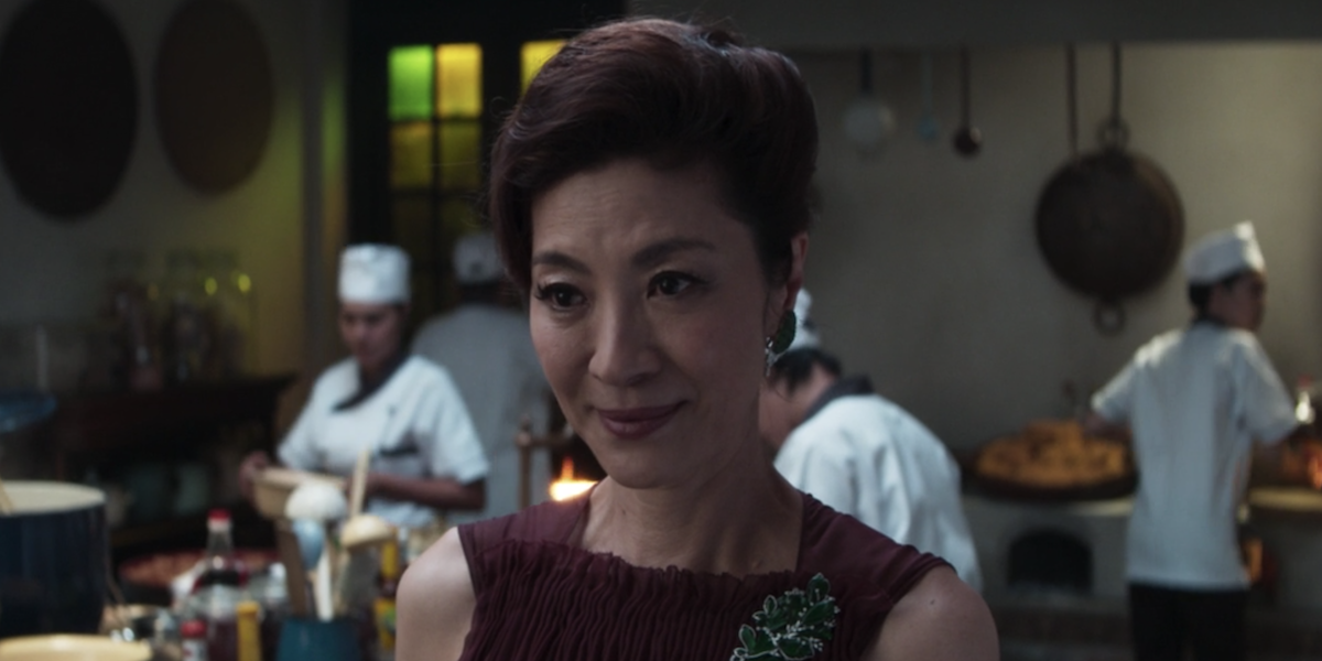 Crazy Rich Asians scene in a kitchen surrounded by cooks
