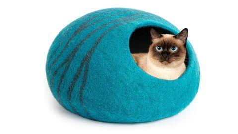 A cat in the Meowfia Premium Felt Cat Cave