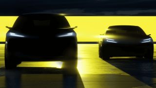 Silhouette of two electric cars on yellow and black background