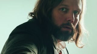 Rich Robinson in a green jacket looking at the camera.