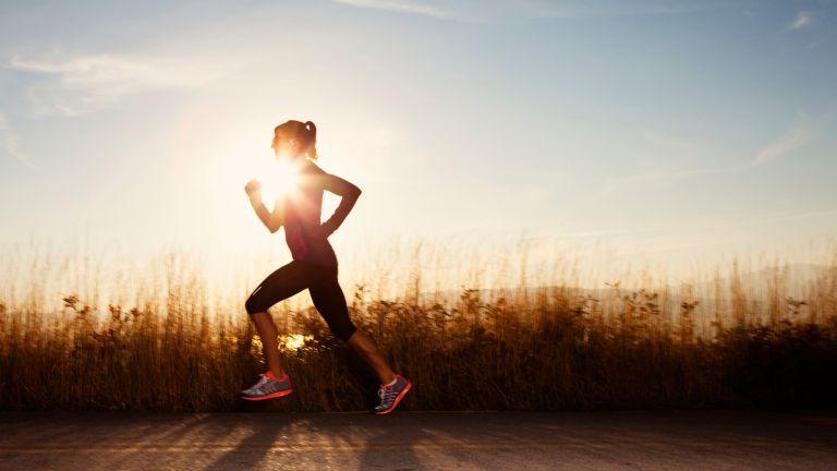 woman running along roadside