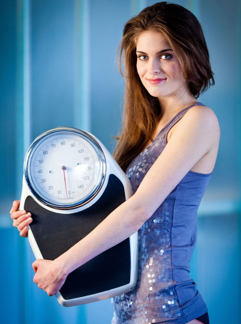 woman holding scales-alternate day fasting diet