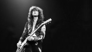 Led Zeppelin guitarist Jimmy Page playing live