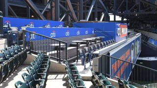 The custom seating system at Citi Field, engineered by Staging Concepts, includes 18 portable platforms with custom railing and aluminum enclosures along with four sets of modular stair units.