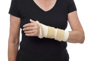 A woman wears a splint on her forearm and wrist.