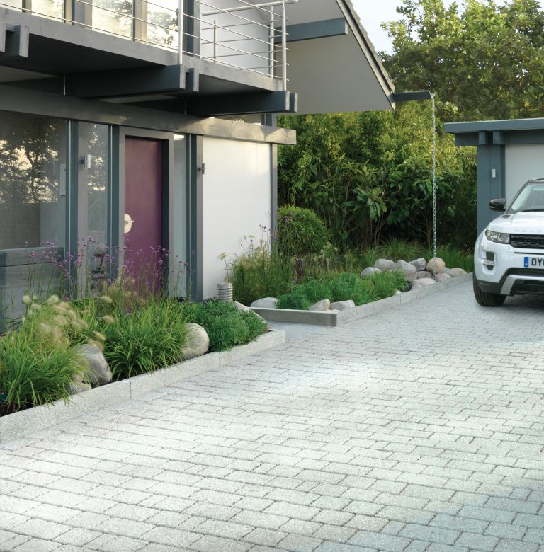 Driveway with planting by Stonemarket