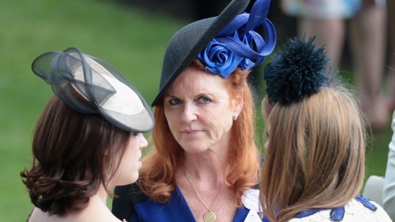 Princess Eugenie, Sarah Ferguson, Duchess of York and Princess Beatrice hold hands in the parade ring on day 4 of Royal Ascot at Ascot Racecourse on June 19, 2015 in Ascot, England.