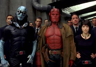 Ron Perlman leads a group of fellow creatures and men in suits