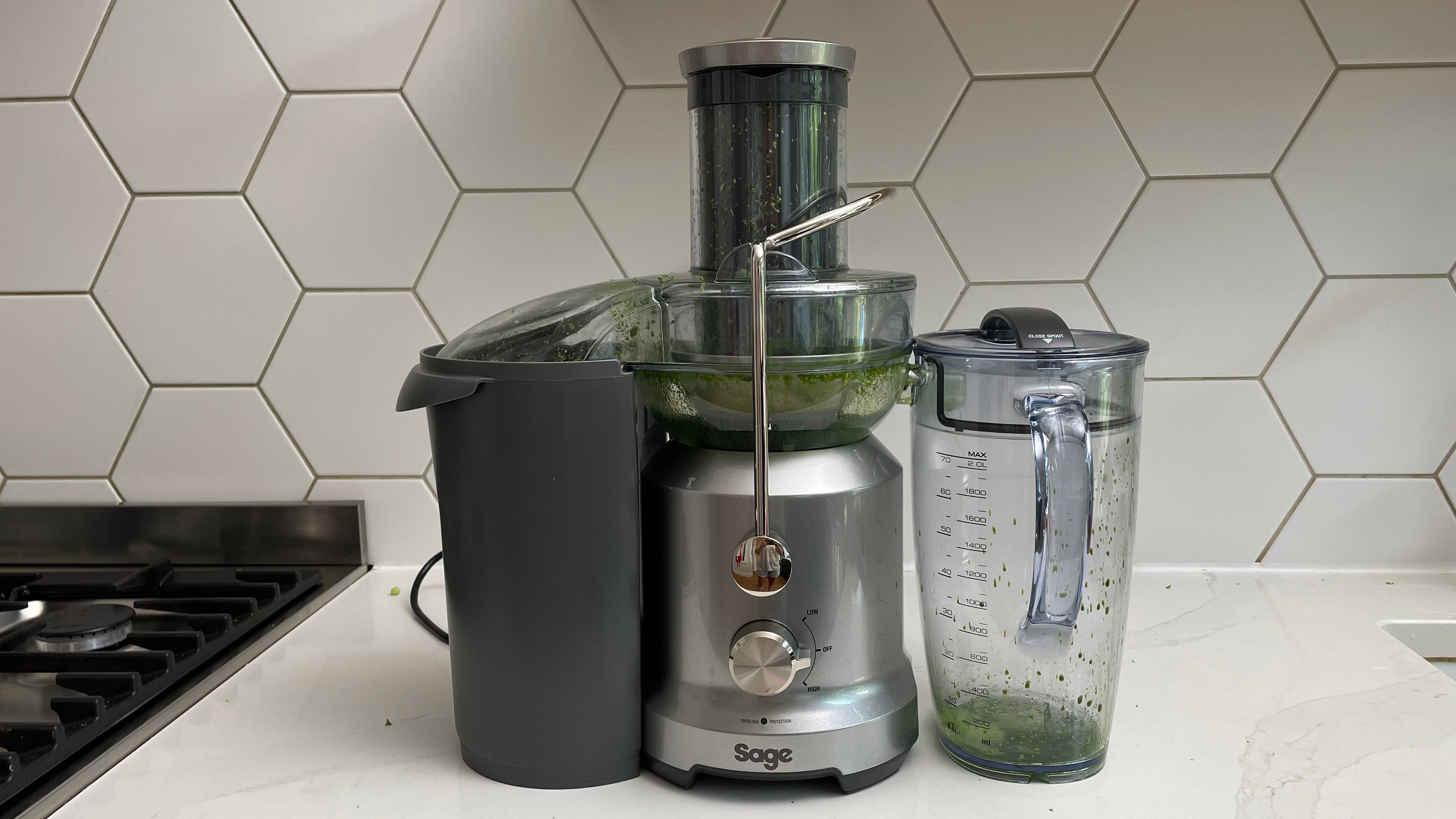 Breville the Juice Fountain Cold on a kitchen countertop used to juice Kale