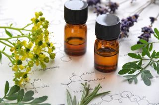 Small brown bottles contain essential oils