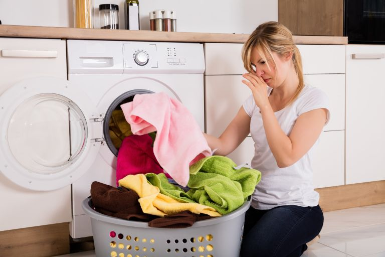 Why do my clothes smell after washing?