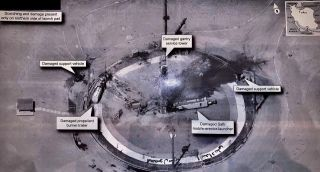 A secret spy satellite snapped this high-resolution image of the aftermath of an Iranian missile disaster.