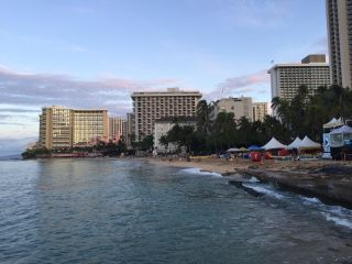 People take in the partial solar eclipse on Waikiki Beach on Oahu.