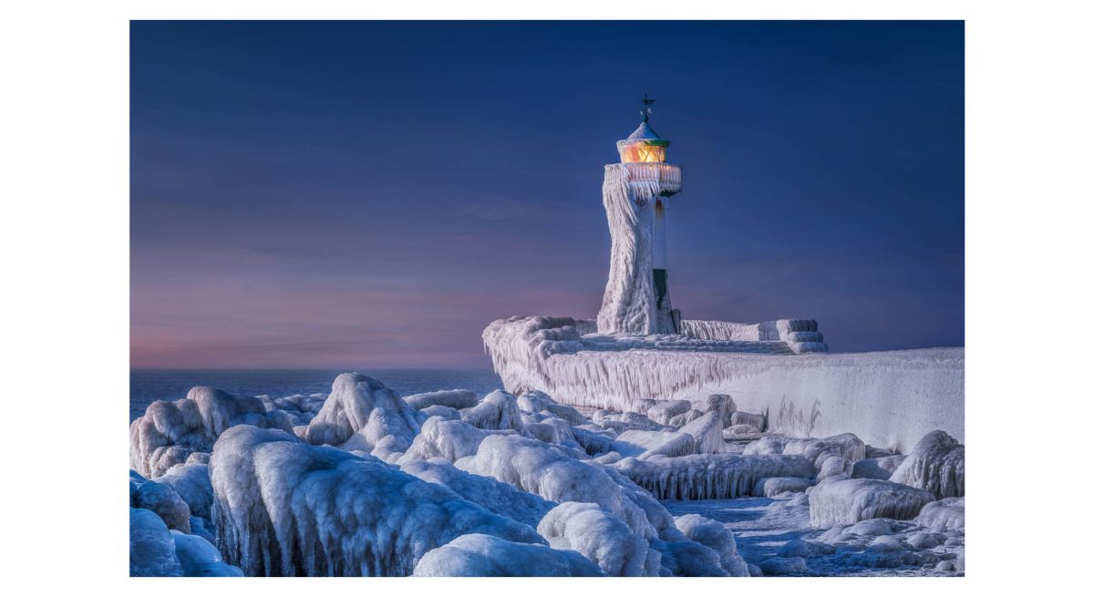 Stunning frozen lighthouse shot tops world's largest photo competition