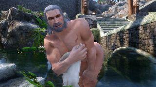 Geralt takes a bath in a Skyrim mod