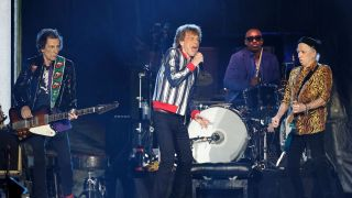 (from left) Ronnie Wood, Mick Jagger, Steve Jordan, and Keith Richards of The Rolling Stones perform at The Dome at America's Center stadium on September 26, 2021 in St. Louis, Missouri