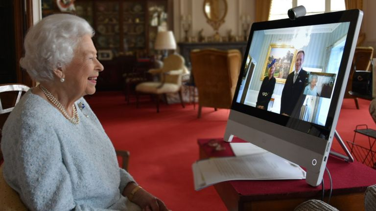 Buckingham Palace handout picture of Queen Elizabeth II, who is in residence at Windsor Castle, speaking by video link during a virtual diplomatic audience with His Excellency Dr. Ferenc Kumin, Ambassador of Hungary, and his wife, Viktoria, who were at London's Buckingham Palace where such audiences are traditionally held.