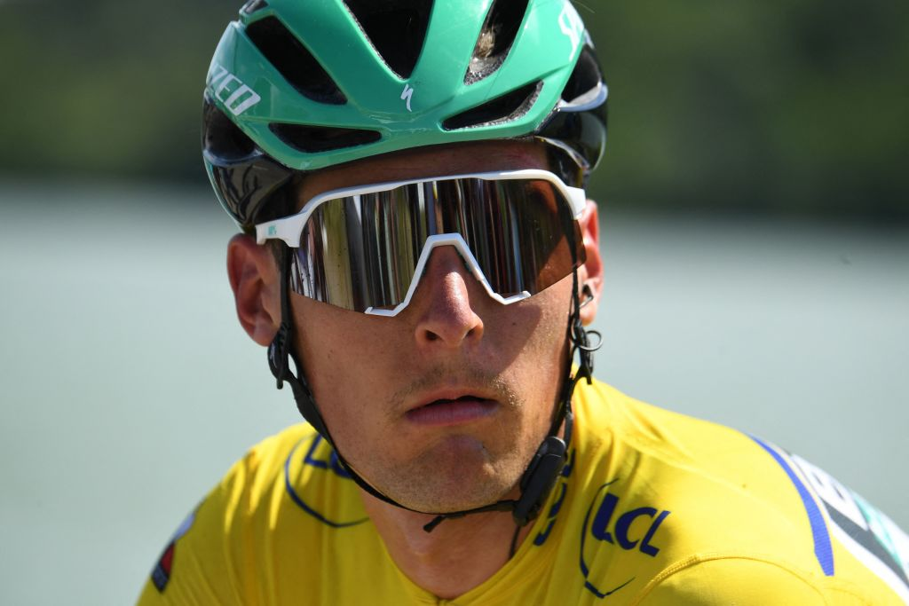 Team Boras Lukas Postlberger of Austria wearing the overall leaders yellow jersey looks on after the fifth stage of the 73rd edition of the Criterium du Dauphine cycling race a 175km between SaintChamond and SaintVallier on June 3 2021 Photo by Alain JOCARD AFP Photo by ALAIN JOCARDAFP via Getty Images