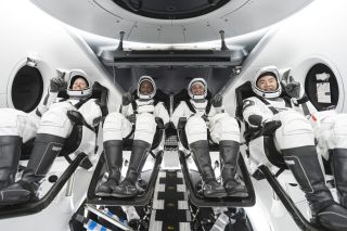 The crew for SpaceX's Crew-1 mission. From left to right are NASA astronauts Shannon Walker, mission specialist; Victor Oliver, pilot; and Mike Hopkins, Crew Dragon commander; and JAXA astronaut Soichi Noguchi, mission specialist.