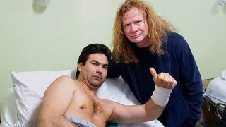 A picture of Dave Mustaine visiting injured Megadeth fan Fabina Young at a hospital in Argentina