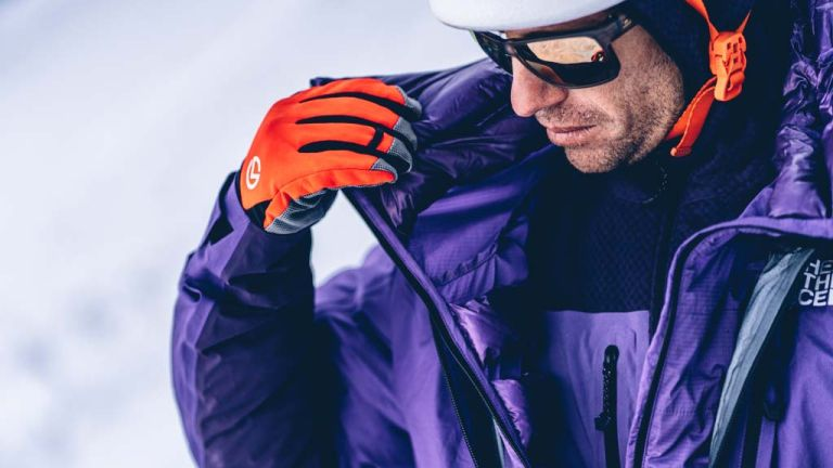 Man on snowy mountainside wearing The North Face Summit Series kit