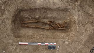 This grave in France was reopened during the early Middle Ages. Items were removed, and archaeologists are trying to figure out why.