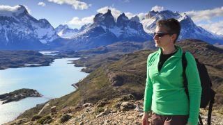 best fleece jackets: hiker wearing fleece jacket and shades