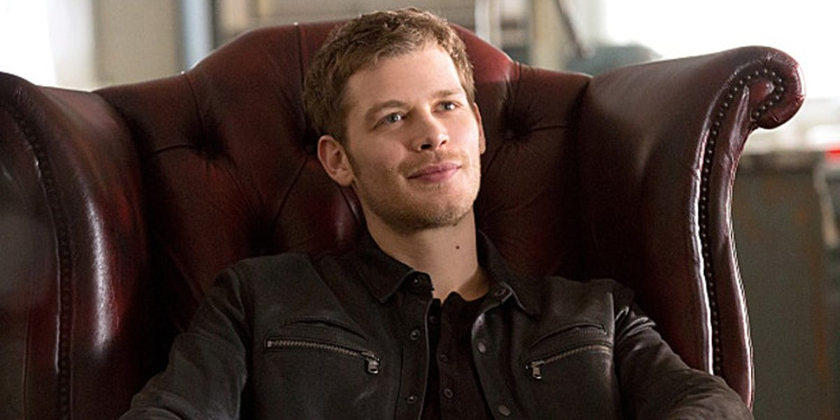 The Originals Klaus Mikaelson smiles while seated in chair The CW