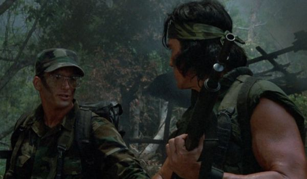 Hawkins telling Billy a joke in Predator