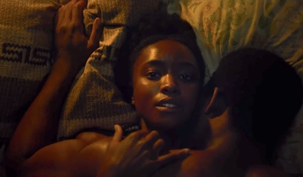 Kiki Layne and Stephen Layne in bed together in If Beale Street Could Talk