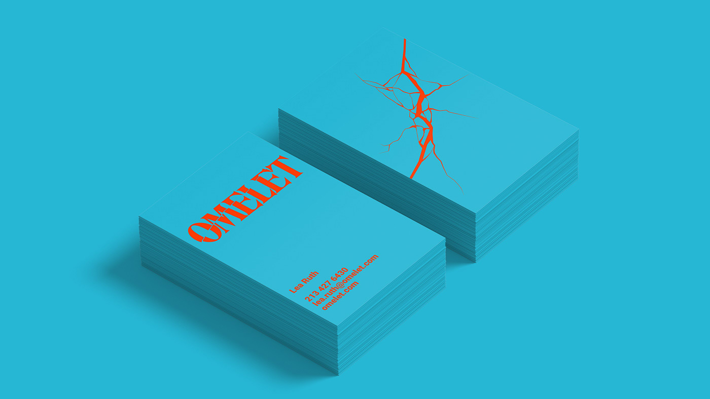 Blue OMELET business cards on a blue background