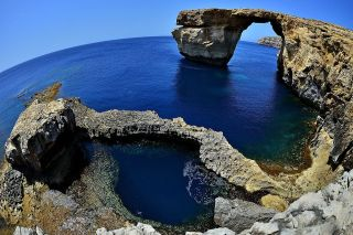 A natural arch in Malta called the Azure Window, which is shown here on May 20, 2014, collapsed in March 2017 after heavy storms hit the area.