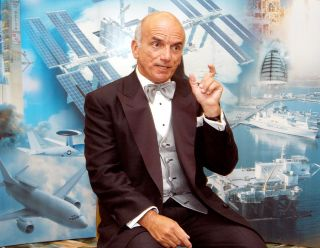 Dennis Tito became the first space tourist when he launched toward the International Space Station in April 2001. Here, he shares his experiences at a space conference in 2003.