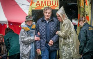 Cold Feet shows Karen and Adam helping David at a festival