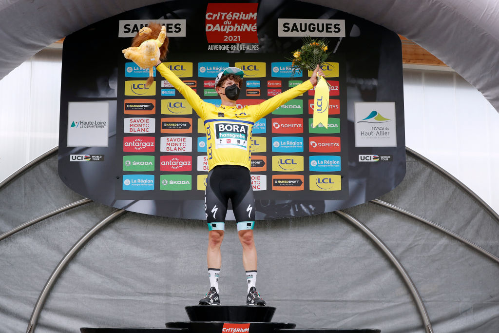 SAUGUES FRANCE MAY 31 Lukas Pstlberger of Austria and Team Bora Hansgrohe yellow leader jersey celebrates at podium during the 73rd Critrium du Dauphin 2021 Stage 2 a 1728km stage from Brioude to Saugues 935m Mask Covid safety measures Mascot UCIworldtour Dauphin on May 31 2021 in Saugues France Photo by Bas CzerwinskiGetty Images
