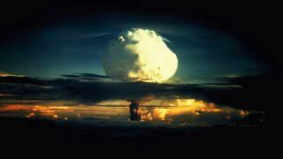 A billowing white mushroom cloud during Operation Ivy, the first test of a hydrogen bomb, at Enewetak Atoll in the Marshall Islands.