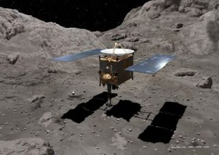 Artist's concept of Japan's Hayabusa spacecraft beginning to gather samples from Itokawa asteroid.